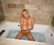 Kelly Madison naked in the tub