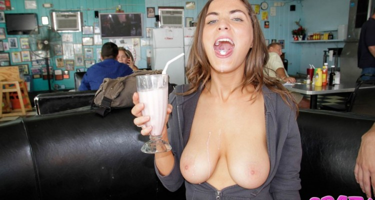 Busty girl flashes her tits during dinner