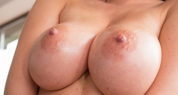 Antonya's luscious breasts close-up