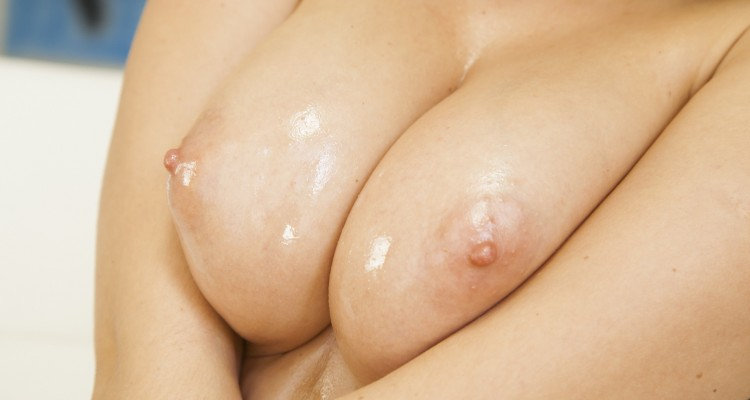 Kendra Star's breasts covered in oil