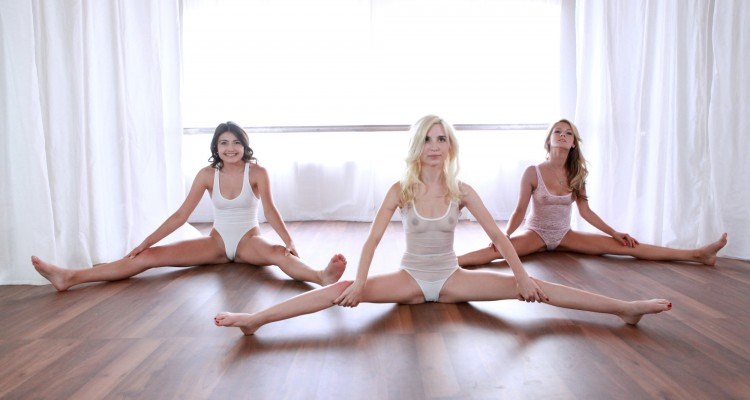three sexy ballerinas with legs spread wide