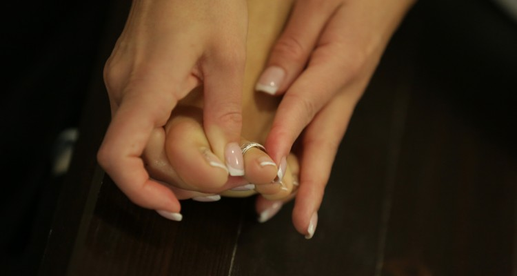 Vicky massaging her feet at 21 Foot Art
