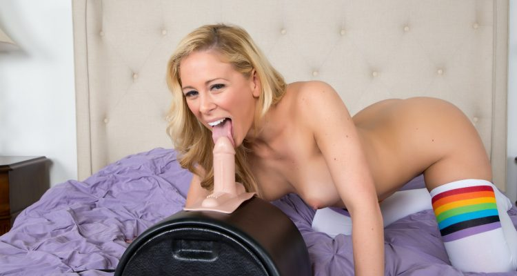cherie licks the dildo before she rides it