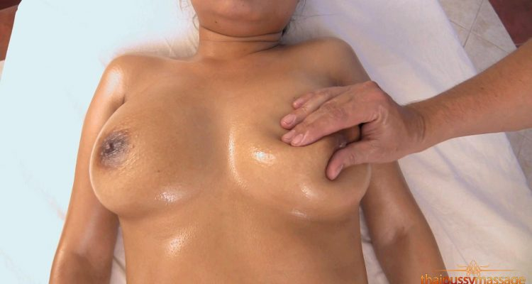 Dusadi's perfect breasts covered in massage oil